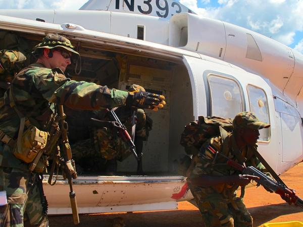 U.S. Special Forces soldier instructs South Sudanese commandos on how to quickly exit a helicopter at a U.S.-run base in Nzara, South Sudan.