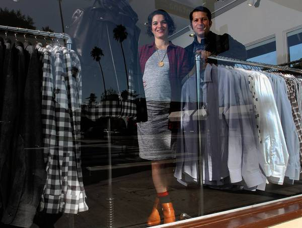 Married partners Adele Berne and Michael Kuhle at their menswear store Epaulet on Montana Avenue in Santa Monica.