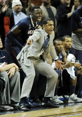 UConn's head coach, Kevin Ollie, gets some back up from the bench from Amida Brimah. The UConn men opened their basketball season against Maryland at the Barclays Center in Brooklyn Friday night.