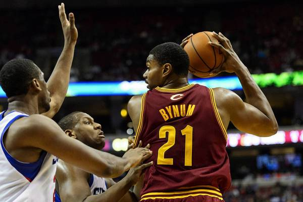 Nov 8, 2013; Philadelphia, PA, USA; Cleveland Cavaliers center Andrew Bynum (21) is defended by Philadelphia 76ers forward Thaddeus Young (21) and center Lavoy Allen (50) during the fourth quarter at Wells Fargo Center.