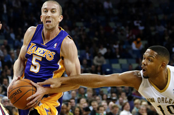 Lakers point guard Steve Blake drives against Pelicans guard Eric Gordon in the first half Friday night in New Orleans.