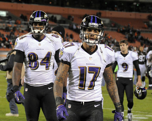 From left to right, Ravens tight end Ed Dickson, wide receiver Tandon Doss and kicker Justin Tucker walk off the field after the 24-18 loss to the Cleveland Browns.