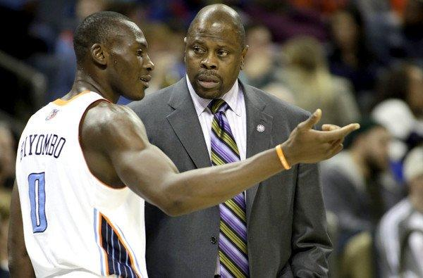 Charlotte Bobcats center Bismack Biyombo talks with acting head coach Patrick Ewing in the first half Friday night.