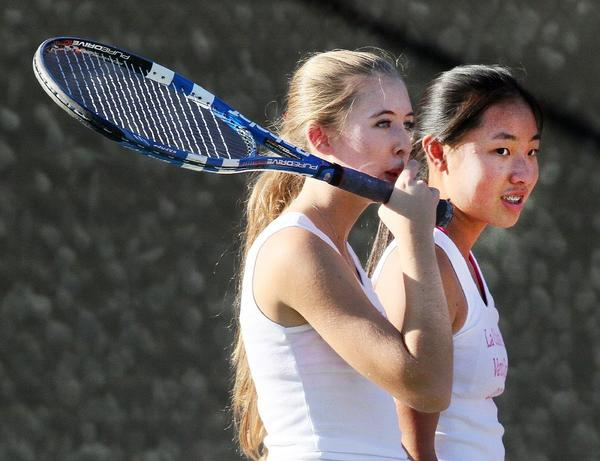 Spartans Emily Swanson, left, and Serena Zheng talk between points on Friday. (Tim Berger Staff Photographer)