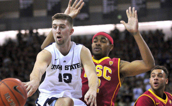 Utah State's Preston Medlin makes a pass in front of USC's Roschon Prince during the Trojans' 78-65 season-opening loss Friday.
