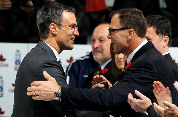 Scott Niedermayer, greeting former Devils teammate Scott Stevens (right), is honored before a game between the Toronto Maple Leafs and New Jersey on Friday night at the Air Canada Centre.