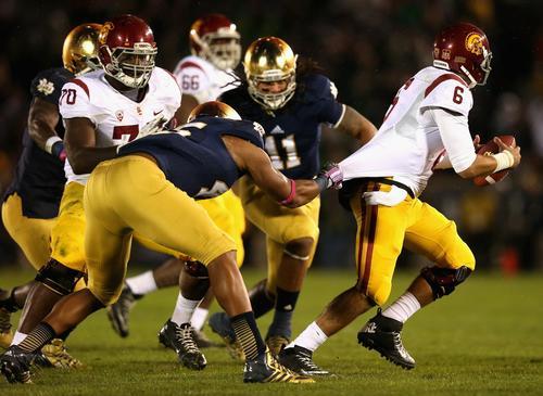 Notre Dame linebacker Romeo Okwara tries to pull down USC quarterback Cody Kessler during the Irish's 14-10 victory on Saturday night.