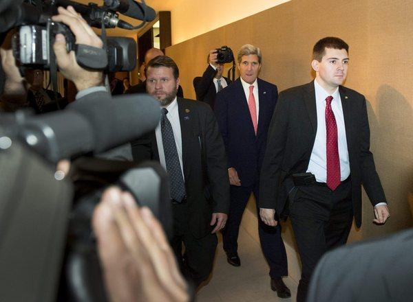 Secretary of State John F. Kerry, second from right, is shown on his way to a meeting Saturday during closed-door nuclear talks at the Intercontinental Hotel in Geneva, Switzerland.
