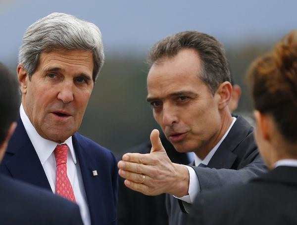 Jean-Luc Chopard, right, Geneva head of protocol, welcomes U.S. Secretary of State John F. Kerry at his arrival at Geneva International Airport in Switzerland on Friday for talks between six world powers and Iran.