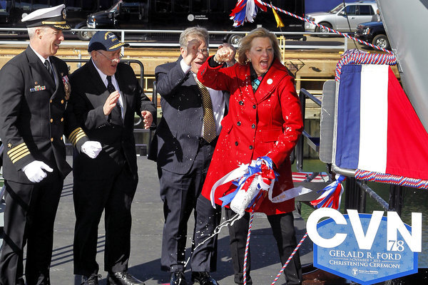 Susan Ford Bales, right, cheers after christening the aircraft carrier Gerald R. Ford at Newport News Shipbuilding on Saturday. Standing from left are John F. Meier, commanding officer of the ship, Sen. Carl Levin, and president of Newport News Shipbuilding Matt Mulherin.