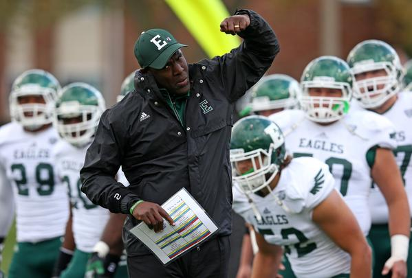 Head coach Ron English of the Eastern Michigan Eagles leads his team onto the field before a game against the Northern Illinois Huskies at Brigham Field on October 26, 2013 in DeKalb