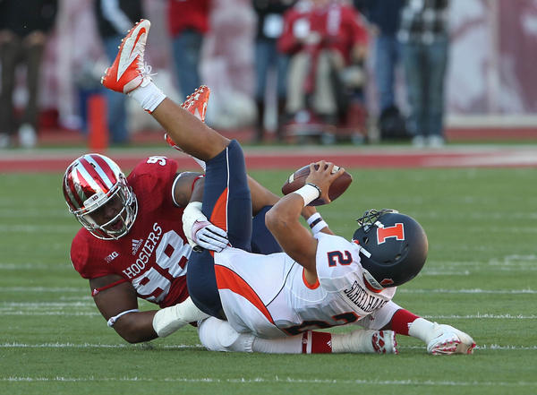 Indiana defensive tackle Darius Latham sacks Illinois quarterback Nathan Scheelhaase during the first quarter.