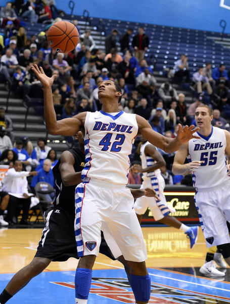 DePaul forward Greg Sequele grabs a rebound against Grambling State during the first half.