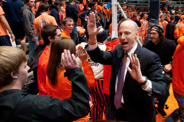 Illini coach John Groce high-fives fans after the game against Alabama State.