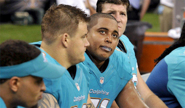 Offensive linemen Richie Incognito, left, and Jonathan Martin, right, on the sidelines during Miami's 38-17 loss to New Orleans on Sept. 30.