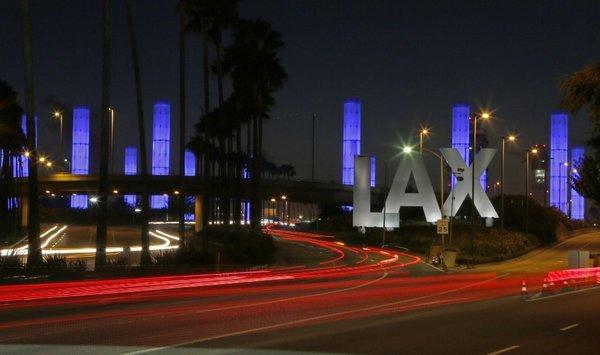 Lighted pylons illuminate the Century Boulevard entrance to Los Angeles International Airport, where an airport security officer was fatally shot Nov. 1.