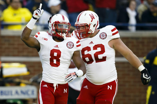 Nebraska running back Ameer Abdullah and offensive linesman Cole Pensick celebrate a touchdown in the first quarter against Michigan.