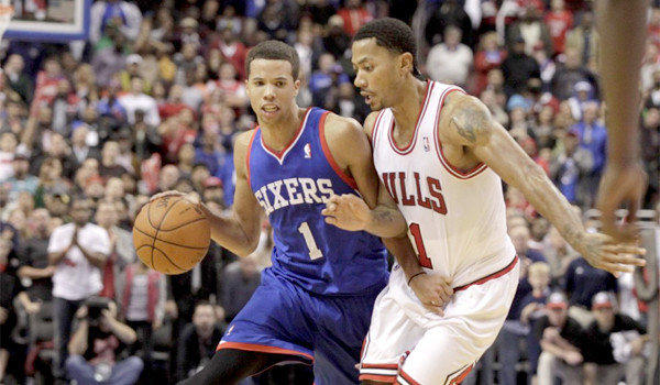 Philadelphia guard Michael Carter-Williams tries to get around the defense of Chicago's Derrick Rose during the 76ers' 107-104 win over the Bulls. Carter-Williams had 26 points and 10 assists in the victory.