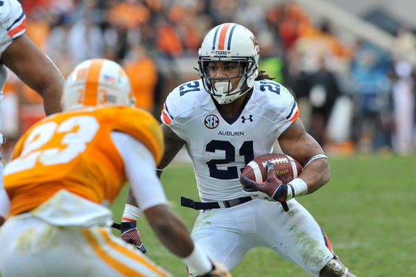 Nov 9, 2013; Knoxville, TN, USA; Auburn Tigers running back Tre Mason (21) rushes against Tennessee Volunteers defensive back Cameron Sutton (23) during the second half at Neyland Stadium. Auburn won 55-23. Mandatory Credit: Jim Brown-USA TODAY Sports ORG XMIT: USATSI-136076
