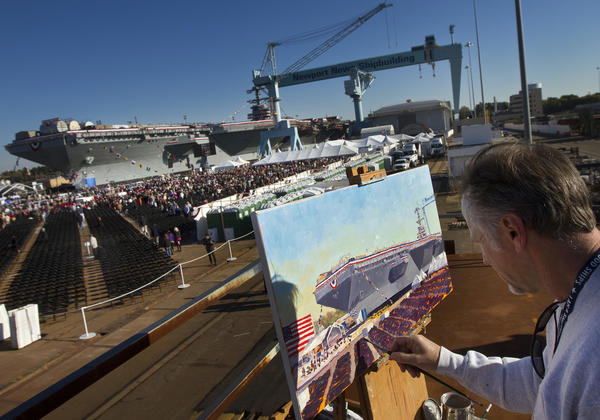 Brian Murphy, an artist from Newport News, paints the scene of Saturday's christening ceremony for the aircraft carrier Gerald R. Ford.