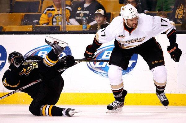 Ducks winger Dustin Penner knocks down Bruins defenseman Torey Krug during a game last week at TD Garden in Boston.