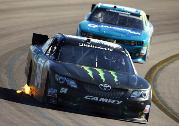 Kyle Busch leads the Nationwide Series Servicemaster 200 on Saturday en route to victory.