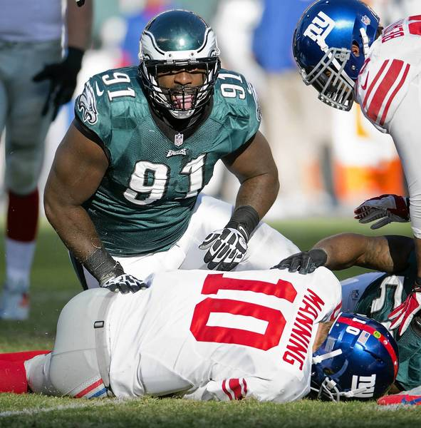 Philadelphia Eagles defensive end Fletcher Cox (91) celebrates a sack of New York Giants quarterback Eli Manning (10) at Lincoln Financial Field in Philadelphia on Sunday, October 27, 2013.