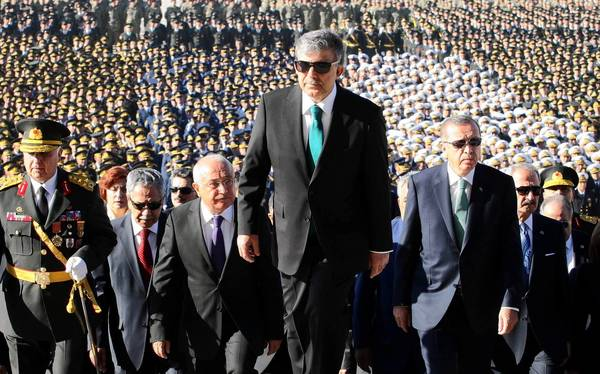 Turkish Prime Minister Recep Tayyip Erdogan, right center, President Abdullah Gul, center, and other leaders attend a national celebration last month. Erdogan rejects the idea that Islamic militant groups could gain a foothold in Turkey.