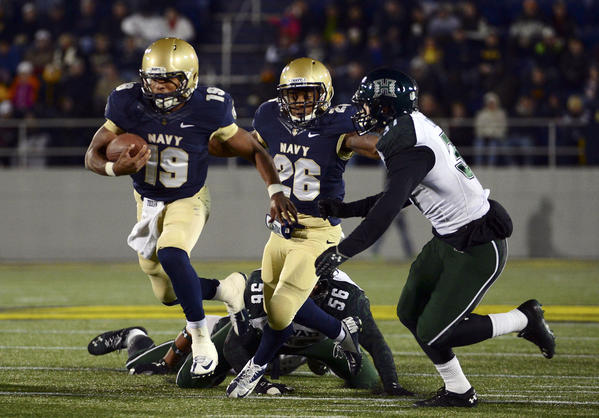 Navy's Keenan Reynolds looks to break free from Hawaii's Brenden Daley during a third-quarter run.