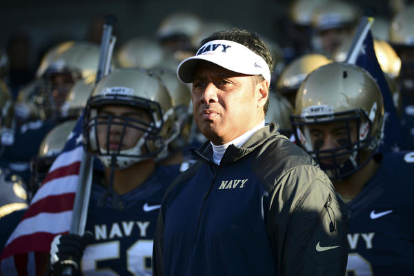Navy's Ken Niumatalolo stand with his team prior to the start of their game against Hawaii.