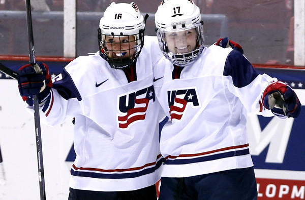 U.S. teammates Kelli Stack (16) and Jocelyne Lamoureux (17) celebrate a goal by Lamoureux during the second period of their game against Sweden on Saturday.