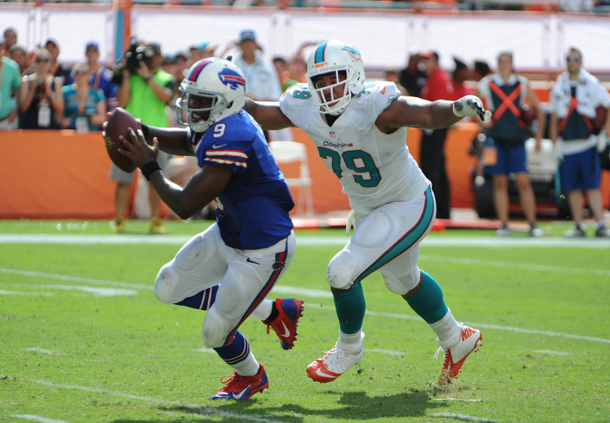 Miami Dolphins Derrick Shelby stops Buffalo Bills quarterback Thad Lewis in the fourth quarter