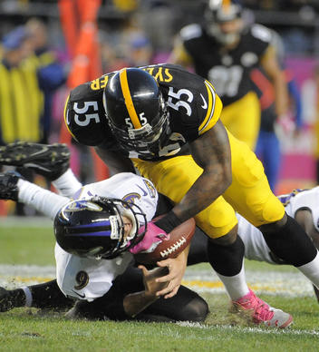 Ravens kicker Justin Tucker, left, is unable to cover an onside kick attempt as he's hit by the Steelers' Stevenson Sylvester in the fourth quarter.