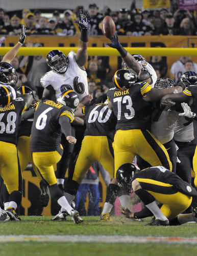 Ravens special teams player Marcus Spears, top left, tries unsuccessfully to block Steelers kicker Shaun Suisham's game-winning field goal as time expired.