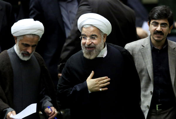 Iranian President Hassan Rouhani, center, is shown Sunday after leaving a session of parliament in Tehran.