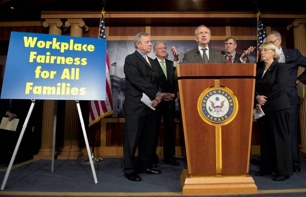 Senate Majority Leader Harry Reid, center, with Democratic Sens. Dick Durbin of Illinois, from left, Tom Harkin of Iowa, Jeff Merkley of Oregon, Patty Murray of Washington and Charles Schumer of New York, talks about the Employment Non-Discrimination Act.