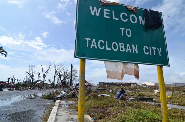 In the Philippine city of Tacloban, residents wash their clothes in a canal after typhoon Haiyan.