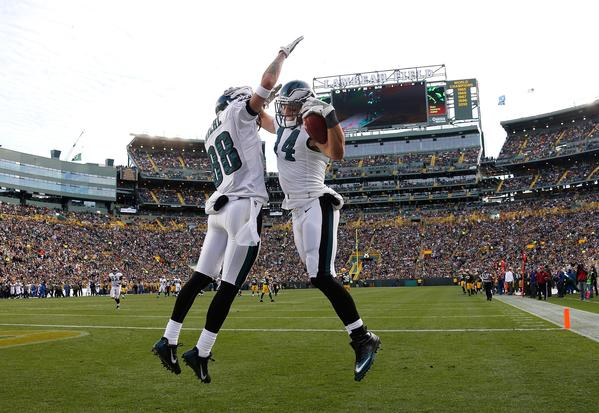 GREEN BAY, WI - NOVEMBER 10: Riley Cooper #14 of the Philadelphia Eagles celebrates a fourth quarter touchdown with Jeff Maehl #88 while playing the Green Bay Packers at Lambeau Field on November 10, 2013 in Green Bay, Wisconsin.