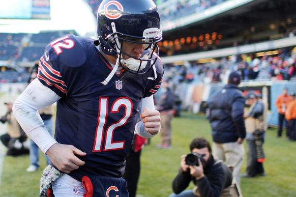 Bears quarterback Josh McCown leaves the field following the loss.