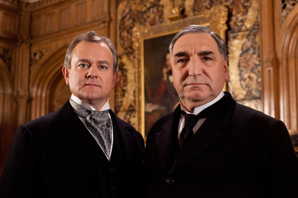 "Hugh Bonneville as Lord Grantham, left, and Jim Carter as Mr. Carson from the series ""Downton Abbey."" The fourth season will debut Jan 5, 2014."