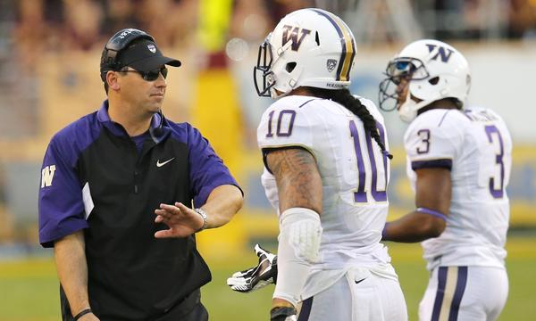 Washington Coach Steve Sarkisian, left, congratulates players John Timu, center, and Cleveland Wallace during a loss to Arizona State on Oct. 19.