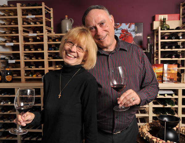 Kathy and Terry Sullivan, in their wine room, which contains several hundred bottles collected from their travels to wineries in the U.S, Canada, Italy, France, New Zealand and Georgia, Russia. The couple, who are both retired teachers, have written two book about wine and are working on their third.