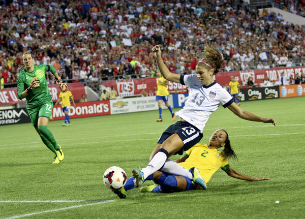 Alex Morgan from the U.S. Women's National Team take a shot on goal in front of Rilany during their game against Brazil at the Citrus Bowl.