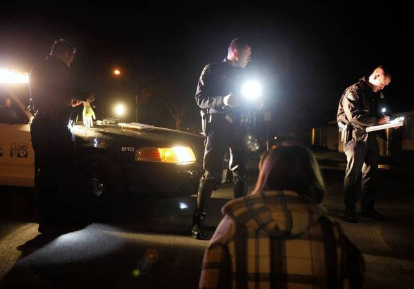 Police in Huntington Beach conduct a DUI investigation in 2011. An Orange County Crime Lab error has led to some inaccurate blood alcohol test results that could affect hundreds of DUI cases.