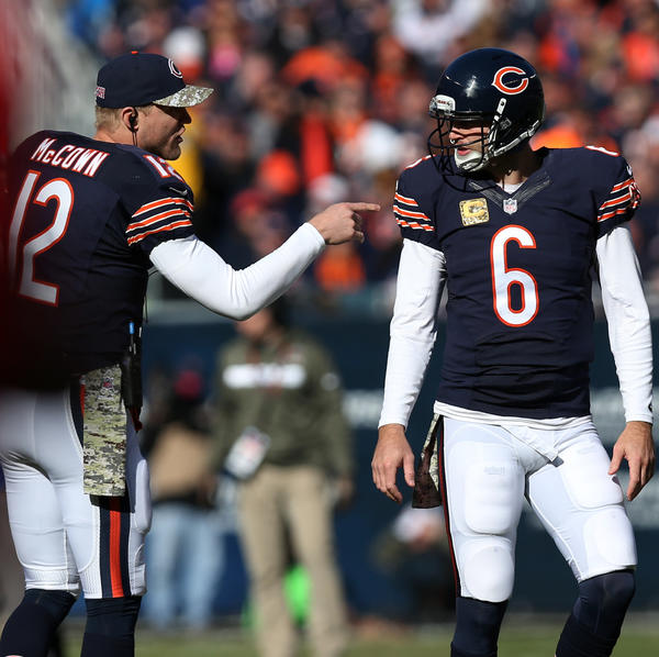 Bears quarterbacks Josh McCown (12) and Jay Cutler (6) talk in the second quarter at Soldier Field.