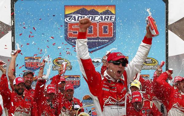 Kevin Harvick, driver of the #29 Budweiser Chevrolet, celebrates in Victory Lane after winning the NASCAR Sprint Cup Series AdvoCare 500 at Phoenix International Raceway on Sunday.