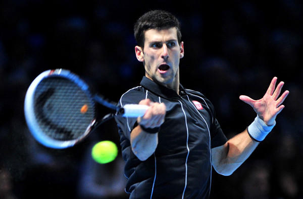 Novak Djokovic returns a shot against Stanislas Wawrinka in the semifinals of the ATP World Tour Finals in London on Sunday.