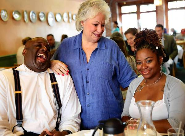 Ina Pinkney chats with Vance Henry, left, and Kyla Williams during an August meeting about business plans. Over the last 33 years, the longtime cook and restaurateur has made it her business to treat people who cross the threshold at Ina's like family.