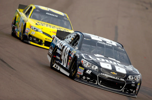 Jimmie Johnson, driver of the No. 48 Lowe's/Kobalt Tools Chevrolet, leads Matt Kenseth, driver of the No. 20 Dollar General Toyota, during the NASCAR Sprint Cup Series AdvoCare 500 at Phoenix International Raceway on Sunday.