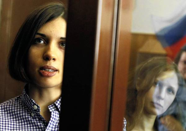 Nadezhda Tolokonnikova, left, pictured in a courtroom cage last year with Pussy Riot bandmate Maria Alyokhina, has not been heard from for three weeks, her husband says.